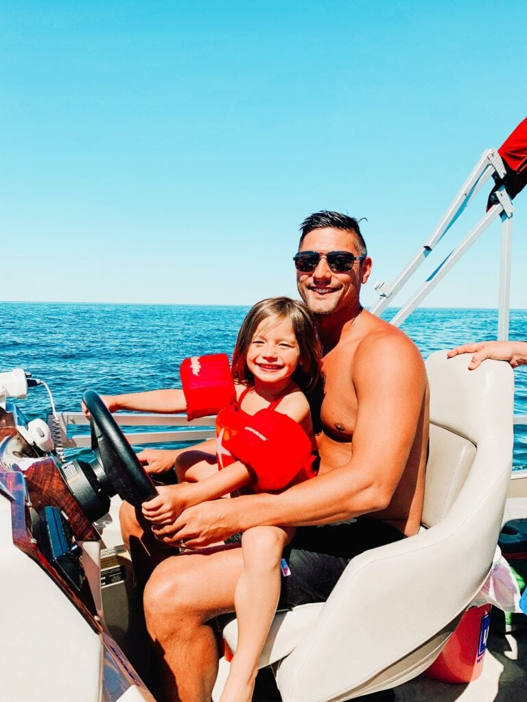 Father and daughter driving a boat