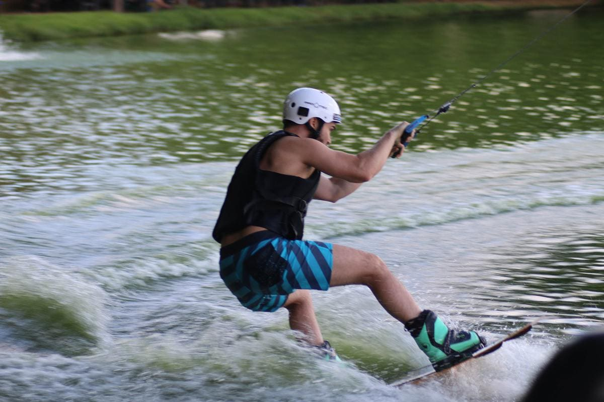Young man practicing wakeboard